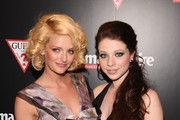 Lydia Hearst and Michelle Trachtenberg walk the red carpet at the GUESS Flagship Boutique opening hosted by Marie Claire and GUESS at GUESS Flagship Boutique on July 22, 2009 in New York City.