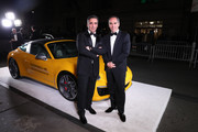 Honorees Avery Lipman and Monte Lipman pose with a Porsche 911 Speedster at the 2018 Angel Ball hosted by Gabrielle's Angel Foundation at Cipriani Wall Street on October 22, 2018 in New York City.