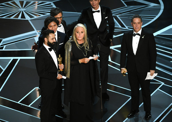 90th Annual Academy Awards - Show [formal wear,suit,tuxedo,event,outerwear,white-collar worker,adrian molina,darla k. anderson,lee unkrich,actors,anthony gonzalez,benjamin bratt,academy awards,l-r,hollywood highland center,show]