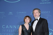 Jury member Robert Guediguian and his wife Ariane Ascaride arrive at the Gala dinner during the 71st annual Cannes Film Festival at Palais des Festivals on May 8, 2018 in Cannes, France.