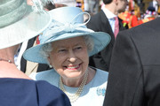 Queen Elizabeth II speaks with a guests at a garden party at Buckingham Palace on June 1, 2017in London, England.
