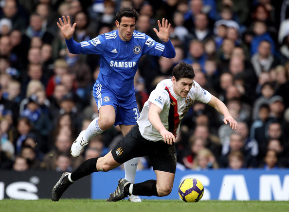 Chelsea v Manchester City - Premier League [player,sports,sports equipment,football player,team sport,ball game,soccer,football,soccer player,international rules football,fouls,juliano belletti,gareth barry,v,tackles,penalty,chelsea,manchester city,premier league,match]