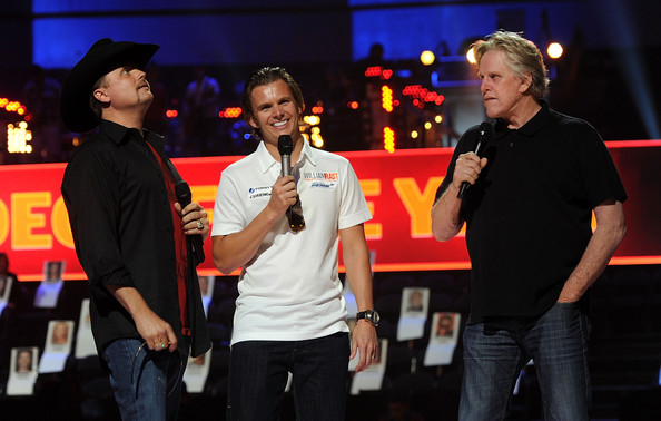 2011 CMT Music Awards - Rehearsals - Day 2 [games,event,performance,indoor games and sports,recreation,technology,stage,talent show,competition,team,john rich,dan wheldon,gary busey,rehearsals,stage,l-r,indianapolis 500,bridgestone arena,nashville,cmt music awards]