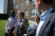 Harriet Harman (1-L), the Labour Member of Parliament for Camberwell and Peckham, speaks to the media as she visits the Ledbury Estate on August 11, 2017 in London, England. Hundreds of residents of the estate are to be evacuated from four tower blocks over safety fears after a survey, ordered after the Grenfell Tower fire, found cracks in the walls leaving it vulnerable to collapse in the event of a gas explosion.