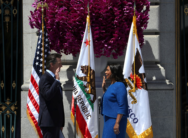 London Breed Sworn In As San Francisco Mayor [people,event,tradition,ceremony,flag,plant,world,festival,flower,tourism,london breed,gavin newsom,mayor,ed lee,office,oath,history,san francisco,california,inauguration]