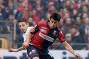 (L_R)Leandro Greco of Hellas Verona competes for the ball with Almeira Diego Perotti of Genoa CFC during the Serie A match between Genoa CFC and Hellas Verona FC at Stadio Luigi Ferraris on February 15, 2015 in Genoa, Italy.
