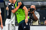 Paulo Dybala of Juventus (left) celebrates with his team-mate Gianluigi Buffon after scoring a goal during the Serie A match between Genoa CFC and Juventus FC at Stadio Luigi Ferraris on June 30, 2020 in Genoa, Italy.