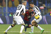 Ioannis Fetfatzidis (C) of Genoa CFC competes for the ball with Hassan Yebda (L) and Marques Loureiro Allan (R) of Udinese Calcio during the Serie A match between Genoa CFC and Udinese Calcio at Stadio Luigi Ferraris on February 16, 2014 in Genoa, Italy.