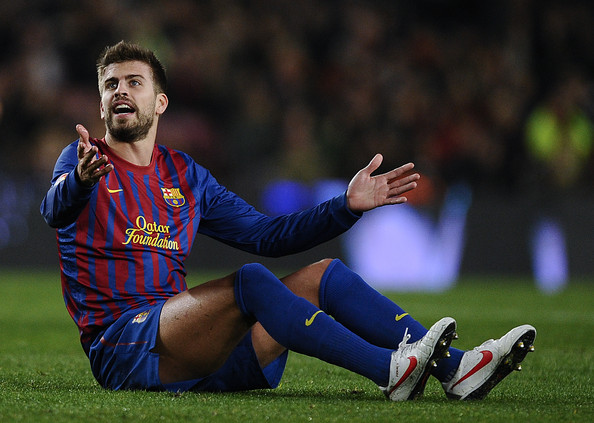Gerard Pique Gerard Pique of FC Barcelona reacts during the round of
