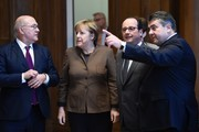 (L-R) French Finance and Economy Minister Michel Sapin, German Chancellor Angela Merkel, French President Francois Hollande and German Vice Chancellor, Economy and Energy Minister Sigmar Gabriel are pictured during a German-French digital conference on December 13, 2016 in Berlin. / AFP / ODD ANDERSEN