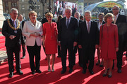Peter Feldmann, ANgela Merkel, Ursula Bouffier, Volker Bouffier, German President Joachim Gauck and Daniela Schadt arrive for events to celebrate the 25th anniversary of German reunification on October 3, 2015 in Frankfurt, Germany. On October 3, 1990, following the end of the Cold War, western-oriented, capitalist and democratic West Germany and post-revolution, formerly communist East Germany reunited into a single state after 41 years of official separation. Though the integration of the two former states into one is seen by most as a success, differences remain, particularly in average incomes and pensions, which in eastern Germany are lower.