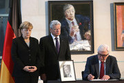 (L to R) German Chancellor Angela Merkel, German President Joachim Gauck and Foreign Minister Frank-Walter Steinmeier (SPD) sign a condolence book for former German Chancellor Helmut Schmidt following his death the day before, in the German federal Chancellery on November 11, 2015 in Berlin, Germany. Schmidt, a German Social Democrat (SPD), led West Germany as chancellor from 1974 until 1982. He died in Hamburg at the age of 96.