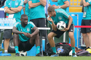 Thomas Mueller (R) of Germanmy jokes iwth team mate Antonio Ruediger  during the Germany Training & Press Conference at Fisht Stadium on June 22, 2018 in Sochi, Russia.