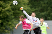 Manuel Neuer safes the ball against Thomas Mueller during the Germany training session ahead of the 2018 FIFA World Cup at CSKA Sports Base on June 13, 2018 in Moscow, Russia.