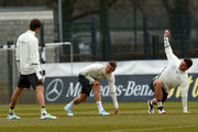Thomas Mueller, Toni Kroos and Mario Gomez (L-R) warm up during a Germany training session ahead of their International friendly match against England at Stadion am Wurfplatz on March 23, 2016 in Berlin, Germany.