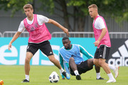 Thomas Mueller (L) and Joshua Kimmich (R) battle for the ball with Antonio Ruediger  during the Germany training session ahead of the 2018 FIFA World Cup at CSKA Sports Base on June 13, 2018 in Moscow, Russia.