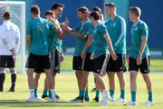Thomas Mueller (C) jokes with his team mates during the Germany Training And Press Conference at Sport Base Vatutinki on June 15, 2018 in Moscow, Russia.
