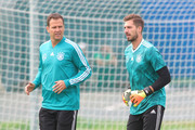 Oliver Bierhoff, Team manager of Germany speak to Kevin Trapp of Germany during a training session during the Germany training session ahead of the 2018 FIFA World Cup at CSKA Sports Base on June 14, 2018 in Moscow, Russia.