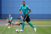 Jerome Boateng of Germany runs with the ball during a Germany training session at Electron Stadium on June 26, 2018 in Kazan, Russia.