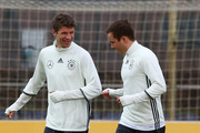 Thomas Mueller (L) of Germany and team mate Mario Goetze (R) run with the ball during a Germany training session ahead of their International frindly match  against England at Stadion am Wurfplatz on March 22, 2016 in Berlin, Germany.