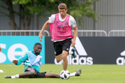 Thomas Mueller (R) battles for the ball with Antonio Ruediger  during the Germany training session ahead of the 2018 FIFA World Cup at CSKA Sports Base on June 13, 2018 in Moscow, Russia.