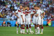 (L-R) Christoph Kramer, Philipp Lahm, Mesut Oezil, Thomas Mueller, Toni Kroos and Bastian Schweinsteiger of Germany wait to take a free kick during the 2014 FIFA World Cup Brazil Final match between Germany and Argentina at Maracana on July 13, 2014 in Rio de Janeiro, Brazil.
