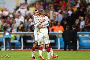 Miroslav Klose (L) and Bastian Schweinsteiger of Germany celebrate after defeating Argentina 1-0 in extra time during the 2014 FIFA World Cup Brazil Final match between Germany and Argentina at Maracana on July 13, 2014 in Rio de Janeiro, Brazil.