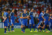 A dejected Maxi Rodriguez of Argentina looks on with teammates after being defeated by Germany 1-0 in extra time during the 2014 FIFA World Cup Brazil Final match between Germany and Argentina at Maracana on July 13, 2014 in Rio de Janeiro, Brazil.