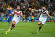 Mario Goetze of Germany (L) celebrates scoring his team's first goal with Thomas Mueller during the 2014 FIFA World Cup Brazil Final match between Germany and Argentina at Maracana on July 13, 2014 in Rio de Janeiro, Brazil.