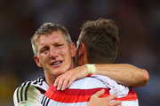 Bastian Schweinsteiger and Miroslav Klose of Germany  celebrate defeating Argentina 1-0 in the 2014 FIFA World Cup Brazil Final match between Germany and Argentina at Maracana on July 13, 2014 in Rio de Janeiro, Brazil.