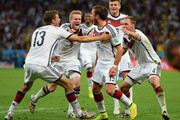 Mario Goetze of Germany (C) celebrates scoring his team's first goal in extra time with teammates Thomas Mueller, Andre Schuerrle, Toni Kroos and Benedikt Hoewedes during the 2014 FIFA World Cup Brazil Final match between Germany and Argentina at Maracana on July 13, 2014 in Rio de Janeiro, Brazil.