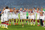 Germany celebrate around the World Cup trophy after defeating Argentina 1-0 in extra time during the 2014 FIFA World Cup Brazil Final match between Germany and Argentina at Maracana on July 13, 2014 in Rio de Janeiro, Brazil.