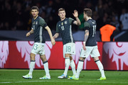 Toni Kroos (C) of Germany celebrates scoring his team's first goal with his team mate Thomas Mueller (L) and Marco Reus (R) during the International Friendly match between Germany and England at Olympiastadion on March 26, 2016 in Berlin, Germany.