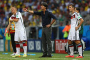Head coach Joachim Loew of Germany (C) gestures as Bastian Schweinsteiger (L) and Miroslav Klose (R) wait to enter the match during the 2014 FIFA World Cup Brazil Group G match between Germany and Ghana at Castelao on June 21, 2014 in Fortaleza, Brazil.