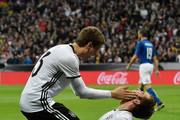 Thomas Mueller of Germany congratulates Mario Goetze after he scored the second goal during the International Friendly match between Germany and Italy at Allianz Arena on March 29, 2016 in Munich, Germany.