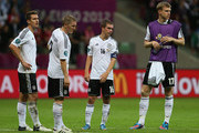 (L-R)  Miroslav Klose, Bastian Schweinsteiger, Philipp Lahm and Per Mertesacker show their dejection after the UEFA EURO 2012 semi final match between Germany and Italy at the National Stadium on June 28, 2012 in Warsaw, Poland.