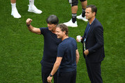 Marcus Sorg, Germany assistant manager, Joachim Loew, Manager of Germany,  and Oliver Bierhoff, Team Co-ordinator speak together during the pitch inspection prior to the 2018 FIFA World Cup Russia group F match between Germany and Mexico at Luzhniki Stadium on June 17, 2018 in Moscow, Russia.
