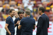 Marcus Sorg, Germany assistant manager, Joachim Loew, Manager of Germany, Oliver Bierhoff, Team Co-ordinator, and Andreas Koepke, Germany goalkeeping coach speak together during the pitch inspection prior to the 2018 FIFA World Cup Russia group F match between Germany and Mexico at Luzhniki Stadium on June 17, 2018 in Moscow, Russia.