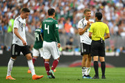 Thomas Mueller of Germany argues after being shown a yellow card by Referee Cesar Ramos during the 2018 FIFA World Cup Russia group F match between Germany and Mexico at Luzhniki Stadium on June 17, 2018 in Moscow, Russia.