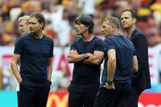 Marcus Sorg, Germany assistant manager, Joachim Loew, Manager of Germany, Oliver Bierhoff, Team Co-ordinator, and Andreas Koepke, Germany goal keeping coach look on during the pitch inspection prior to the 2018 FIFA World Cup Russia group F match between Germany and Mexico at Luzhniki Stadium on June 17, 2018 in Moscow, Russia.