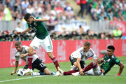 Thomas Mueller and Joshua Kimmich of Germany challenge for the ball with Raul Jimenez and Jesus Gallardo of Mexico during the 2018 FIFA World Cup Russia group F match between Germany and Mexico at Luzhniki Stadium on June 17, 2018 in Moscow, Russia.