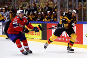 Dennis Seidenberg (R) of Germany and Mathis Olimb of Norway battle for the puck during the 2018 IIHF Ice Hockey World Championship group stage game between Germany and Norway at Jyske Bank Boxen on May 6, 2018 in Herning, Denmark.