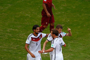 Sami Khedira of Germany, Mario Goetze and Thomas Mueller celebrate their team's third goal during the 2014 FIFA World Cup Brazil Group G match between Germany and Portugal at Arena Fonte Nova on June 16, 2014 in Salvador, Brazil.
