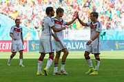 Thomas Mueller of Germany (2nd R) celebrates with teammates Sami Khedira (2nd L) and Mario Goetze (R) after scoring his team's third goal during the 2014 FIFA World Cup Brazil Group G match between Germany and Portugal at Arena Fonte Nova on June 16, 2014 in Salvador, Brazil.