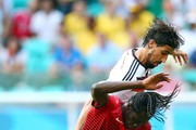 Eder (L) of Portugal battles for the ball with Sami Khedira of Germany during the 2014 FIFA World Cup Brazil Group G match between Germany and Portugal at Arena Fonte Nova on June 16, 2014 in Salvador, Brazil.