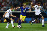 Emil Forsberg of Sweden is challenged by Thomas Mueller and Joshua Kimmich of Germany during the 2018 FIFA World Cup Russia group F match between Germany and Sweden at Fisht Stadium on June 23, 2018 in Sochi, Russia.