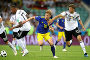 Emil Forsberg of Sweden is tackled by Jerome Boateng and Thomas Mueller of Germany  during the 2018 FIFA World Cup Russia group F match between Germany and Sweden at Fisht Stadium on June 23, 2018 in Sochi, Russia.