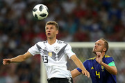 Thomas Mueller of Germany and Andreas Granqvist of Sweden compete for the ball during the 2018 FIFA World Cup Russia group F match between Germany and Sweden at Fisht Stadium on June 23, 2018 in Sochi, Russia.
