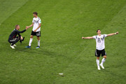 Thomas Mueller of Germany consoles Robin Olsen of Sweden while Mario Gomez of Germany celebrates following the 2018 FIFA World Cup Russia group F match between Germany and Sweden at Fisht Stadium on June 23, 2018 in Sochi, Russia.
