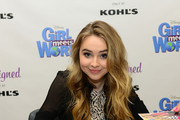 Disney Channel talent Sabrina Carpenter autographs Disney D-Signed Sparkle Asymmetrical Tiger Tunic from the Kohl's exclusive D-Signed collection, inspired by Girl Meets World during special in store appearance on September 13, 2014 in Quakertown, Pennsylvania.